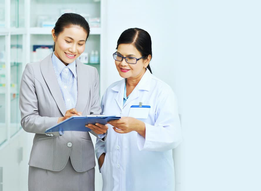 Business woman showing document to pharmacy worker