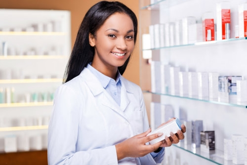 pharmacist holding a box of medicine